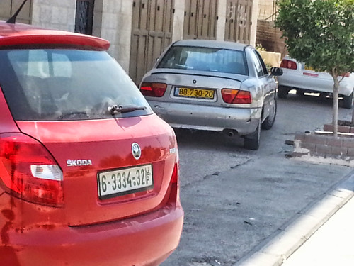 Two licence plates coexist in Palestine